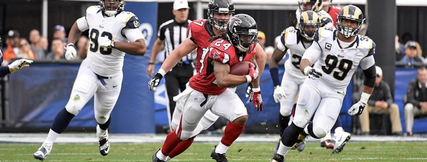 Devonta Freeman runs with the ball against the Rams.