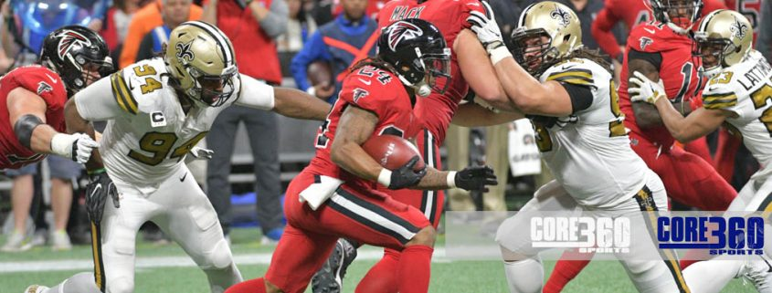 Devonta Freeman runs the ball against the Saints defense.