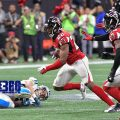 Keanu Neal collects a tipped pass by Grady Jarrett for an interception.
